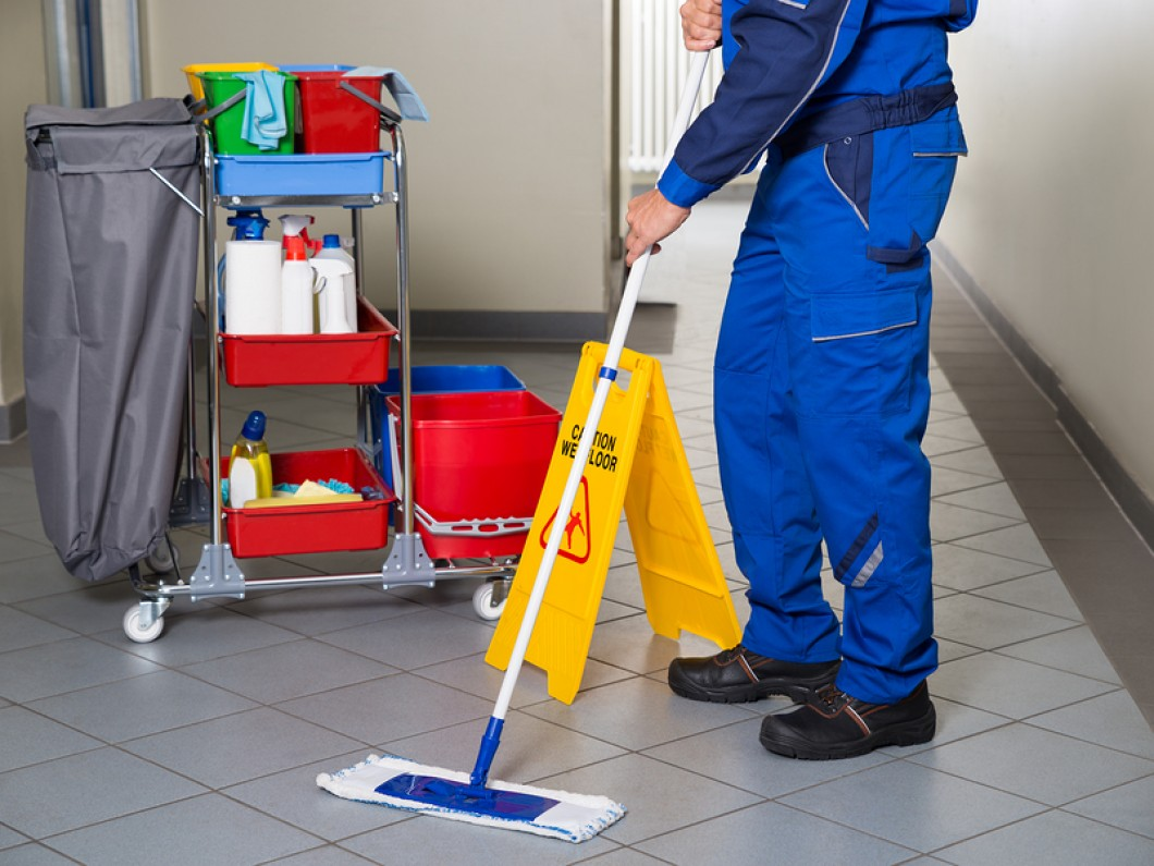 Janitor Cleaning Floor with Supplies